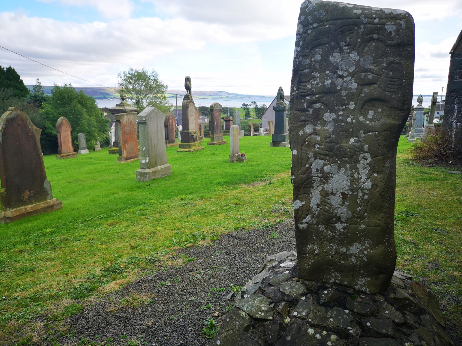 The Kilmorie Stone stands in the churchyard of the early Kirkcolm Church